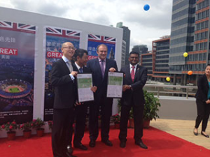The UK Energy Secretary Ed Davey handing over the formal certificates during the UK-China trade visit